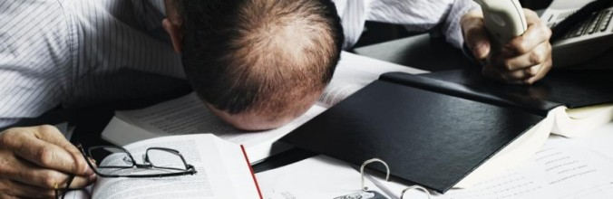 man-with-head-down-on-desk-860x280